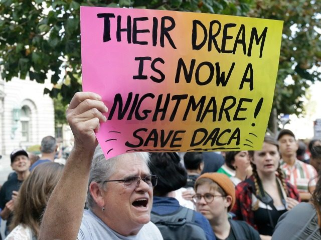 Judy Weatherly, a supporter of the Deferred Action for Childhood Arrivals (DACA), holds up a sign during a protest outside of the Federal Building in San Francisco, Tuesday, Sept. 5, 2017. President Donald Trump on Tuesday began dismantling DACA, the government program protecting hundreds of thousands of young immigrants who …
