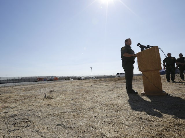 Roy Villarreal, acting Chief Patrol Agent of the Border Patrol, San Diego Sector, speaks during a news conference in front of secondary fencing along the border separating San Diego from Tijuana, Mexico, Tuesday, Sept. 26, 2017, in San Diego. The federal government said Tuesday that contractors began building eight prototypes …