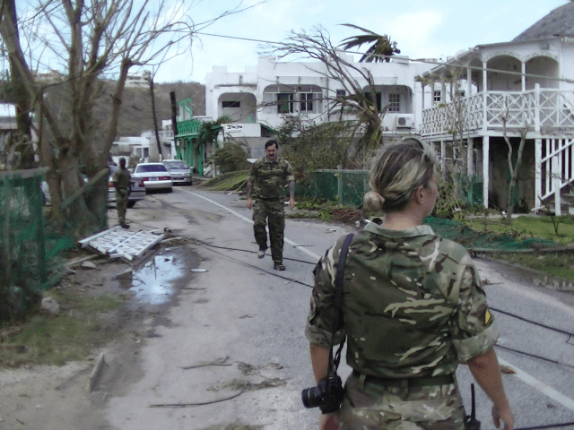 In this undated photo provided by the Ministry of Defence on Friday, Sept. 8, 2017, members of the British Army's RLC regiment (Royal Logistics Corps) conduct a reconnaissance of the exit from the beach ahead of landing personnel, stores and vehicles, in Anguilla. French, British and Dutch military authorities rushed …