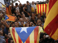 People hold 'Esteladas' (Catalan pro-independence flags) during a protest in front of the Economy headquarters of Catalonia's regional government in Barcelona on September 20, 2017 Thousands took to the streets of Barcelona as Spanish police detained 13 Catalan government officials in a crackdown ahead of an independence referendum which Madrid …