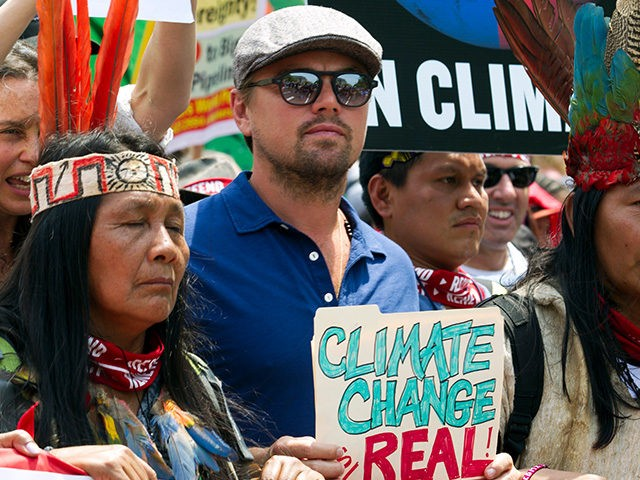 US actor Leonardo DiCaprio (2nd L) marches with a group of indigenous people from North and South America, during the People's Climate March in Washington DC, on April, 29, 2017. (JOSE LUIS MAGANA/AFP/Getty Images)