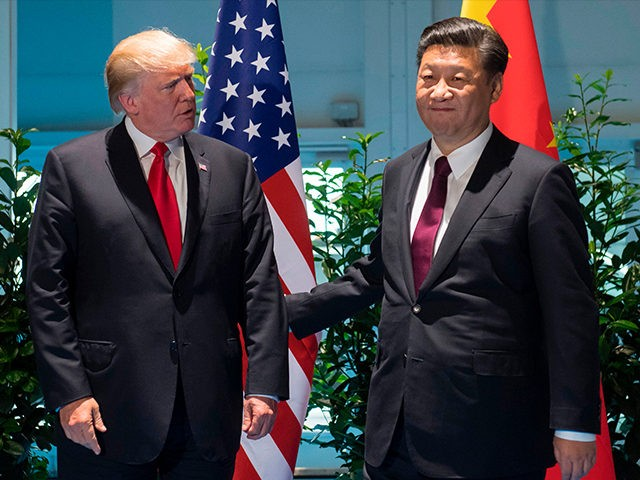 US President Donald Trump and Chinese President Xi Jinping (R) arrive prior to a meeting on the sidelines of the G20 Summit in Hamburg, Germany, July 8, 2017. / AFP PHOTO / POOL / SAUL LOEB (Photo credit should read SAUL LOEB/AFP/Getty Images)