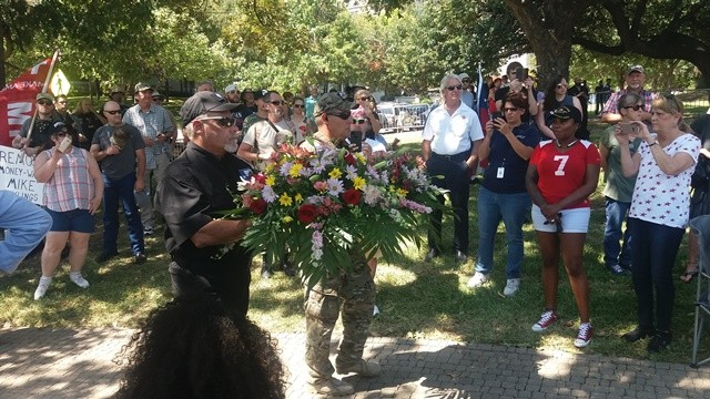 Floral procession during Save the Monument rally held in Lee Park 091617