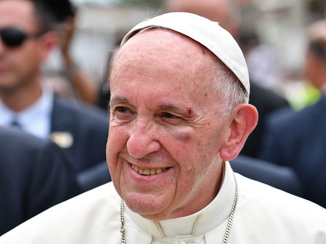 TOPSHOT - Pope Francis, showing a bruise around his left eye and eyebrow caused by an accidental hit against the popemobile's window glass while visiting the old sector of Cartagena,Colombia, is greeted by faithful on September 10, 2017. Nearly 1.3 million worshippers flocked to a mass by Pope Francis on …