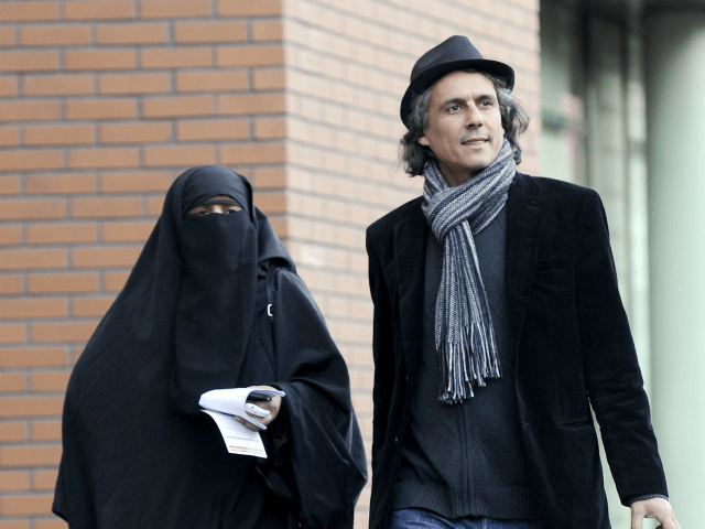 French businessman Rachid Nekkaz (R) walks with Kenza Drider (R), candidate for the 2012 French presidential election, on December 12, 2011 in Paris, after Drider appeared at the police tribunal for violating France's niqab ban. Since a burqa and niqab ban came into force in France with the threat of …
