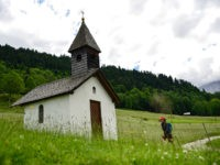 GARMISCH-PARTENKIRCHEN, GERMANY - JUNE 24: A hiker walks towards a small chapel in the Bavarian Alps on June 24, 2015 near Garmisch-Partenkirchen, Germany. The Bavarian Alps are a popular summer tourist destination and offer ample opportunity for hiking, rock climbing and mountain climbing. (Photo by Philipp Guelland/Getty Images)