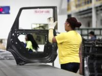 WARREN, MI - JANUARY 22: A worker handles a door that came out of the new $63 million press at the Fiat Chrysler Automobiles US Warren Stamping Plant January 22, 2016 in Warren, Michigan. FCA US officially dedicated the new press line featuring a $63 million high-speed press at the …