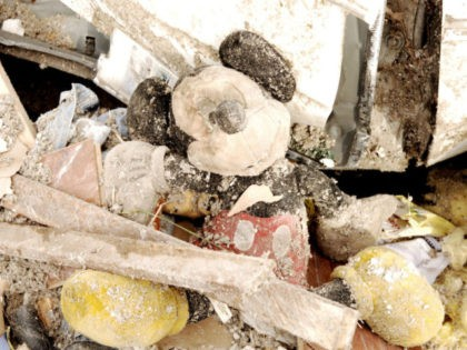 EVANSVILLE, IN - NOVEMBER 7: A damaged Mickey Mouse toy lies in the rubble and debris at the East Brook Mobile Home Park November 7, 2005 in Evansville, Indiana. At least 22 people were killed and more than 200 were injured when a tornado ripped through northern Kentucky and southern …