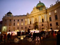 VIENNA, AUSTRIA - DECEMBER 05: The entrance to the Hofburg, a section of the President of Vienna is seen during sunset on December 5, 2016 in Vienna, Austria. The town of Vienna is the federal capital of Austria as well as one of the nine federal states, the city has …