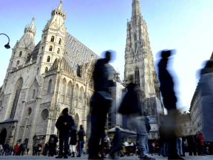 VIENNA, AUSTRIA - DECEMBER 05: Tourists walk by Domkirche St. Stephan on December 5, 2016 in Vienna, Austria. The town of Vienna is the federal capital of Austria as well as one of the nine federal states, the city has a population of 2.6 million citizens. (Photo by Alexander Koerner/Getty …