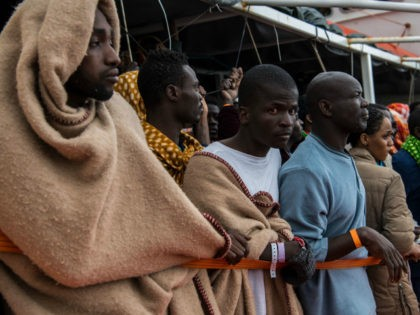 POZZALLO, ITALY - FEBRUARY 19: Refugees and migrants wait on deck of the Spanish NGO Proactiva Open Arms rescue vessel Golfo Azzurro to disembark after being rescued off Libyan coast north of Sabratha, Libya on February 19, 2017 in Pozzallo, Italy. 466 migrants were rescued in high seas last Friday …