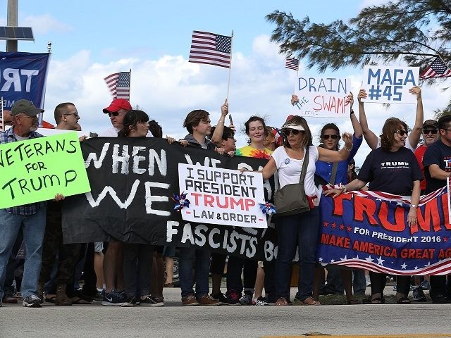WEST PALM BEACH, FL - MARCH 04: Supporters of President Donald Trump and people against his presidency stand near each other down the road from the Mar-a-Lago resort home of President Trump on March 4, 2017 in West Palm Beach, Florida. President Trump spent part of the weekend at the …