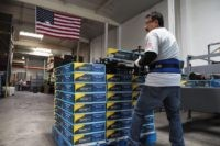 A worker stacks packaged Beautyrest bed frames at the Hollywood Bed Frame Company factory in Commerce, California, seven miles (11 km) southeast from downtown Los Angeles, April 14, 2017. The company held an event to mark an upcoming expansion which will double the size of manufacturer's facility and workforce, adding …