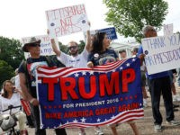 WASHINGTON, DC - JUNE 3: Demonstrators gather outside the White House to show support for President Donald Trump on June 3, 2017 in Washington, D.C. President Trump recently withdrew the United States from the Paris Climate Accord in hopes of growing jobs and cutting regulations. (Photo by Aaron P. Bernstein/Getty Images)