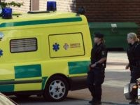 Stockholm, SWEDEN: Police and ambulance are seen 02 July 2006 at the site where a man opened fire with an automatic weapon and wounded a woman in the leg in the north of Stockholm. Police mounted a huge operation and later found the gunman dead in the elevator of an …