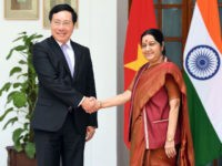 Vietnam's Deputy Prime Minister and Minister of Foreign Affairs Pham Binh Minh (L) and Indian External Affairs Minister Sushma Swaraj shake hands ahead of a meeting in New Delhi on July 4, 2017. Vietnam's deputy prime minister is on an official visit to India. / AFP PHOTO / PRAKASH SINGH …