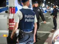Policemen stand guard the Boulevard Emile Jacqmain in the city centre of Brussels on August 25, 2017, where a man is alleged to have attacked soldiers with a knife and was shot. A knife-wielding man attacked a soldier in Brussels on August 25, 2017, before being 'neutralised' by troops present …