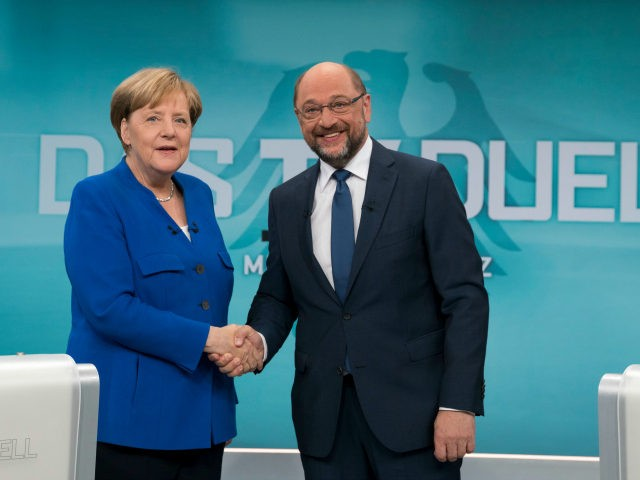 BERLIN, GERMANY - SEPTEMBER 3: In this handout picture provided by German television channel ARD, German Chancellor and Christian Democrat (CDU) Angela Merkel and German Social Democrat (SPD) and chancellor candidate Martin Schulz shake hands prior to a televised debate at ARD television studios on September 3, 2017 in Berlin, …