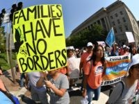 Immigrants and supporters demonstrate during a rally in support of the Deferred Action for Childhood Arrivals (DACA) program Hotel on September 5, 2017 in Washington DC. Trump on Tuesday ended DACA for 800,000 people brought to the US illegally as minors, leaving their future in serious doubt and triggering a …