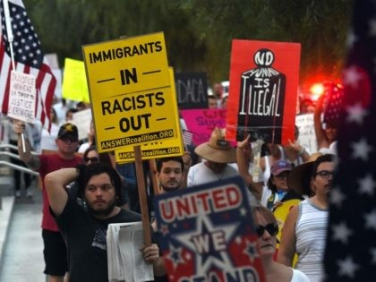"Immigrants and supporters chant during a ""We Rise for the Dream"" rally to oppose U.S. President Donald Trump's order to end DACA near the Trump International Hotel & Tower Las Vegas on September 10, 2017 in Las Vegas, Nevada. The Obama-era Deferred Action for Childhood Arrivals program protects young immigrants who grew up in the U.S. after arriving with their undocumented parents from deportation to a foreign country. Trump's executive order removes protection for about 800,000 current ""dreamers,"" about 13,000 of whom live in Nevada. Congress has the option to replace the policy with legislation before DACA expires on March 5, 2018."