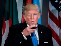 US President Donald Trump sips a glass after making a toast during a luncheon at the United Nations headquarters during the 72nd session of the United Nations General Assembly September 19, 2017 in New York. / AFP PHOTO / Brendan Smialowski (Photo credit should read BRENDAN SMIALOWSKI/AFP/Getty Images)