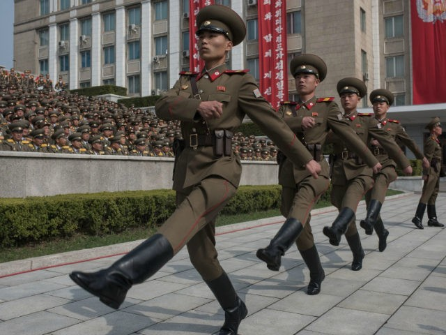 Korean People's Army (KPA) soldiers march to their positions prior to a military parade marking the 105th anniversary of the birth of late North Korean leader Kim Il-Sung, in Pyongyang on April 15, 2017. / AFP PHOTO / ED JONES (Photo credit should read ED JONES/AFP/Getty Images)