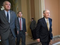 Senate Budget Committee members Sen. Luther Strange, R-Ala., left, and Sen. John Boozman, R-Ark., center, walk with Senate Majority Leader Mitch McConnell, R-Ky, right, as they leave a closed-door meeting with Treasury Secretary Steven Mnuchin after working on a tax code overhaul, at the Capitol in Washington, Tuesday, Sept. 12, …
