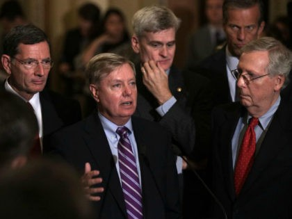 WASHINGTON, DC - SEPTEMBER 19: U.S. Sen. Lindsey Graham (R-SC) (2nd L) speaks as (L-R) Sen. John Barrasso (R-WY), Sen. Bill Cassidy (R-LA), Sen. John Thune (R-SD), and Senate Majority Leader Sen. Mitch McConnell (R-KY) listen during a news briefing after the weekly Senate Republican policy luncheon at the Capitol …