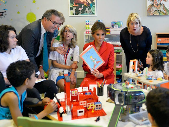 First Lady Melania Trump speaks with children as she visits Necker Hospital for children on July 13, 2017 in Paris, France. The United States of America President Donald Trump and his wife are on a 2 days visit to Paris. (Photo by Aurelien Meunier/Getty Images)