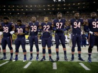 Members of the Chicago Bears link arms during the singing of the national anthem before the game against the Green Bay Packers at Lambeau Field on September 28, 2017 in Green Bay, Wisconsin. (Photo by Jonathan Daniel/Getty Images)