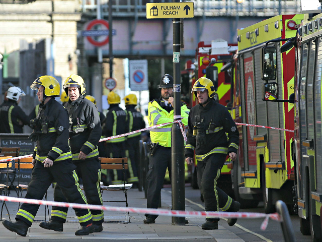 Members of the emergency services work outside Parsons Green underground tube station in west London on September 15, 2017, following an incident on an underground tube carriage at the station. Police and ambulance services said they were responding to an 'incident' at Parsons Green underground station in west London on Friday, following media reports of an explosion. A Metro.co.uk reporter at the scene was quoted by the paper as saying that a white container exploded on the train and passengers had suffered facial burns.