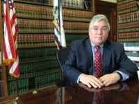 West Virginia Attorney General Patrick Morrisey is shown Thursday, March 3, 2016, outside the state Capitol in Charleston, W.Va. Morrisey's coal-dependent state is helping lead a lawsuit against President Barack Obama's new clean-power rules. In February the U.S. Supreme Court issued a stay of the rules until legal challenges are resolved. (AP Photo/John Raby)
