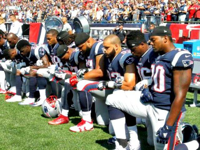 Patriots Kneel AFP