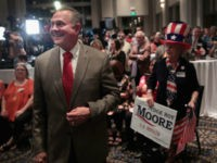 Alabama GOP Senate nominee Roy Moore greets supporters at his victory party on Tuesday night. Scott Olson /Getty Images