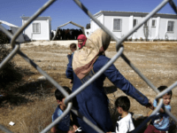 Migrants women from Syria walk with their children in a refugee camp in Kokkinotrimithia, outside of the capital Nicosia, in the eastern Mediterranean island of Cyprus, on Sunday, Sept. 10, 2017. Cyprus police say a 36-year-old man was arrested Sunday for allegedly driving one of a pair of boats that …