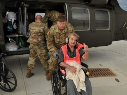 Army Reservists rescue elderly patients from Port Arthur nursing home. (U.S. Army Photo: Captain Matthew Roman)