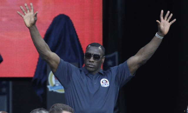 Former NFL football player Shannon Sharpe is introduced during the induction ceremony at the Pro Football Hall of Fame Saturday, Aug. 3, 2013, in Canton, Ohio. (AP Photo/Tony Dejak) ORG XMIT: OHTD10x