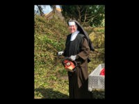 Sister Margaret Ann, dressed in a full habit, was spotted using a chainsaw to clear brush from the fallen debris following Hurricane Irma's destruction in Miami, Florida, according to a video captured by an off-duty police officer.