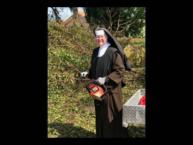 Chainsaw MASS-acre: Nun gets stuck in to clear Hurricane Irma debris