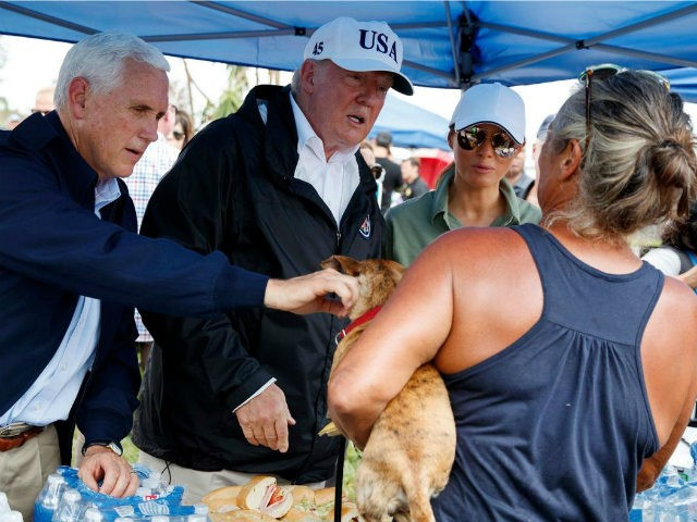 From left, Vice President Mike Pence, President Trump and First Lady Melania Trump greet Florida residents impacted by Hurricane Irma in Naples on Thursday, Sept. 14, 2017.