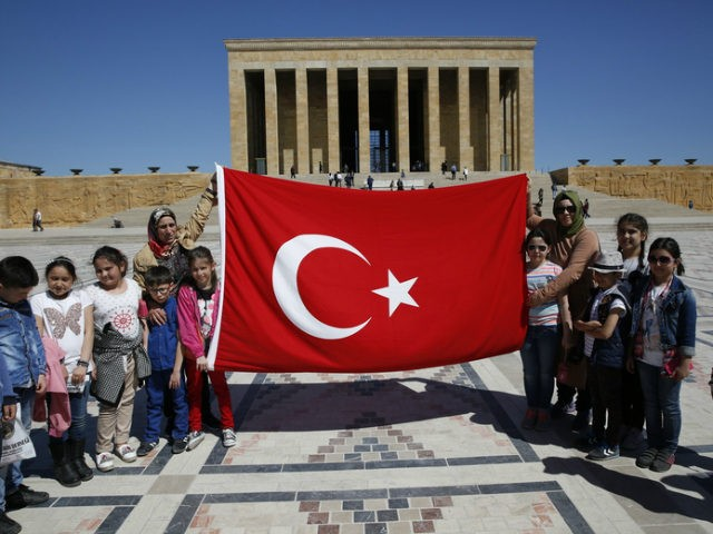 In this March 29, 2017 file photo, schoolchildren visiting the mausoleum of Mustafa Kemal Ataturk, the founder of modern Turkey, poses for pictures with their teachers in Ankara, Turkey. (Lefteris Pitarakis / AP)
