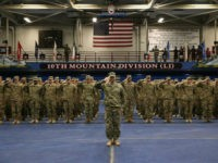 U.S. Army soldiers salute during a welcome-home ceremony after from Iraq on May 17, 2016 at Fort Drum, New York. More than 1,000 members of the 10th Mountain Division 1st Brigade Combat Team are returning home after a 9-month deployment in Iraq as part of Operation Inherent Resolve to train and advise Iraqi forces fighting the Islamic State. The 10th Mountain brigade was replaced in Iraq by the 101st Airborne 2nd Brigade Combat Team based at Ft. Campbell, Kentucky. (Photo by John Moore/Getty Images)