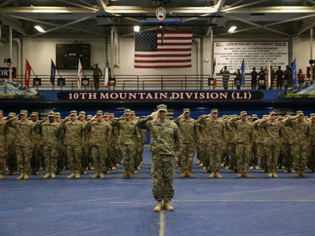 U.S. Army soldiers salute during a welcome-home ceremony after from Iraq on May 17, 2016 at Fort Drum, New York. More than 1,000 members of the 10th Mountain Division 1st Brigade Combat Team are returning home after a 9-month deployment in Iraq as part of Operation Inherent Resolve to train …