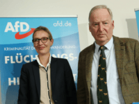 BERLIN, GERMANY - SEPTEMBER 18: Alice Weidel and Alexander Gauland, co-lead candidates of the right-wing, populist Alternative for Germany (AfD) political party, departs after speaking to the media on Islam, immigration and crime next to an AfD poster that reads: 'Crime Through Immigration, The Refugee Wave Leaves Behind Clues!' on …