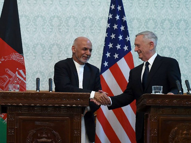 US Defense Secretary Jim Mattis (R) shakes hands with Afghan President Ashraf Ghani after a press conference at the Presidential Palace in Kabul on September 27, 2017. US Defense Secretary Jim Mattis and NATO chief Jens Stoltenberg renewed their commitment to Afghanistan on September 27, as the Taliban launched a …