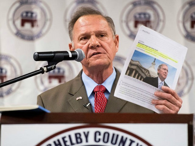 UNITED STATES - AUGUST 4: GOP candidate for U.S. Senate Roy Moore, holding an article about Senate Majority Leader Mitch McConnell, R-Ky., speaks during the U.S. Senate candidate forum held by the Shelby County Republican Party in Pelham, Ala., on Friday, Aug. 4, 2017. The former Chief Justice of the …