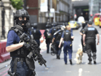 Armed police on St Thomas Street, London, Sunday June 4, 2017, near the scene of Saturday night's terrorist incident on London Bridge and at Borough Market. Several people were killed in the terror attack at the heart of London and dozens injured. Prime Minister Theresa May convened an emergency security …