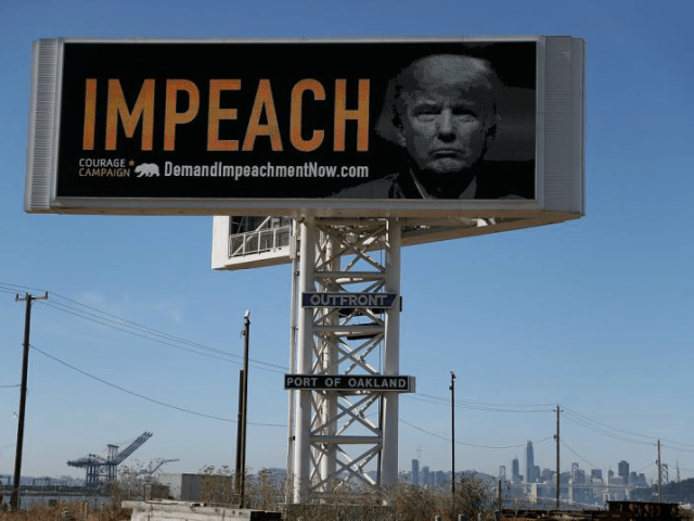 OAKLAND, CA - SEPTEMBER 25: An electronic billboard next to the San Francisco-Oakland Bay Bridge reads 'IMPEACH' with an image of U.S. President Donald Trump on September 25, 2017 in Oakland, California. The Courage Campaign commissioned an electronic billboard calling for the impeachment of U.S. President Donald Trump alongside Interstate …