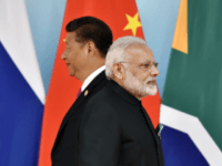 Chinese President Xi Jinping (L) and Indian Prime Minister Narendra Modi attend the group photo session during the BRICS Summit at the Xiamen International Conference and Exhibition Center in Xiamen, southeastern China's Fujian Province on September 4, 2017. Xi opened the annual summit of BRICS leaders that already has been upstaged by North Korea's latest nuclear weapons provocation. / AFP PHOTO / POOL / Kenzaburo FUKUHARA (Photo credit should read KENZABURO FUKUHARA/AFP/Getty Images)