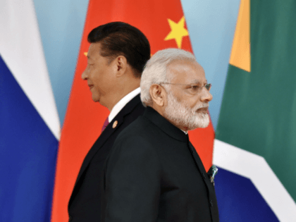 China 's President Xi Jinping (L) and Indian Prime Minister Narendra Modi attend the group photo session during the BRICS Summit at the Xiamen International Conference and Exhibition Center in Xiamen, southeastern China's Fujian Province on September 4, 2017. Xi opened the annual summit of BRICS leaders that already has …